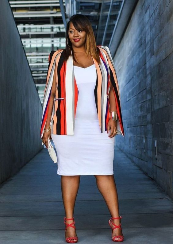 a white fitting knee dress, a colorful striped cape and red strappy heels