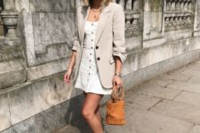 16 a white mini dress on buttons, an off-white oversized blazer, espadrilles and n amber bucket bag