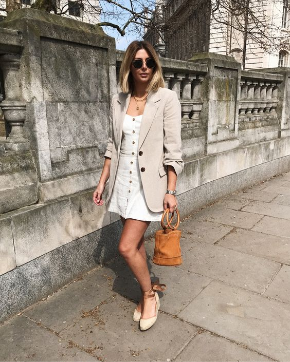 a white mini dress on buttons, an off-white oversized blazer, espadrilles and n amber bucket bag