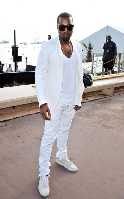 a white suit, a white tee, white sneakers for a formal summer party look by Kanye West