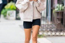 16 a yellow tee, black cycling shorts, white trainers, a neutral oversized denim jacket by Emilie Ratajkovski
