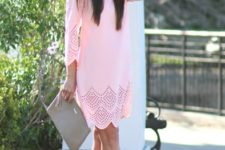 With beige sandals and gray clutch