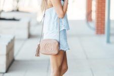With beige tassel bag and light blue high heels