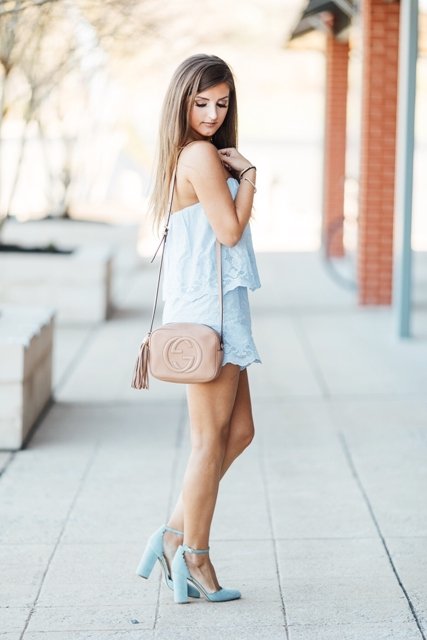 With beige tassel bag and light blue high heels
