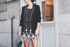 With black blazer, chain strap bag and black pumps