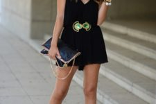 With black clutch and platform sandals