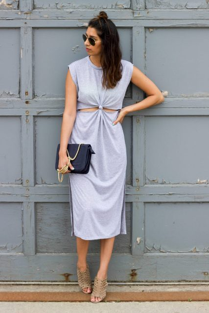 With black leather chain strap bag and beige sandals