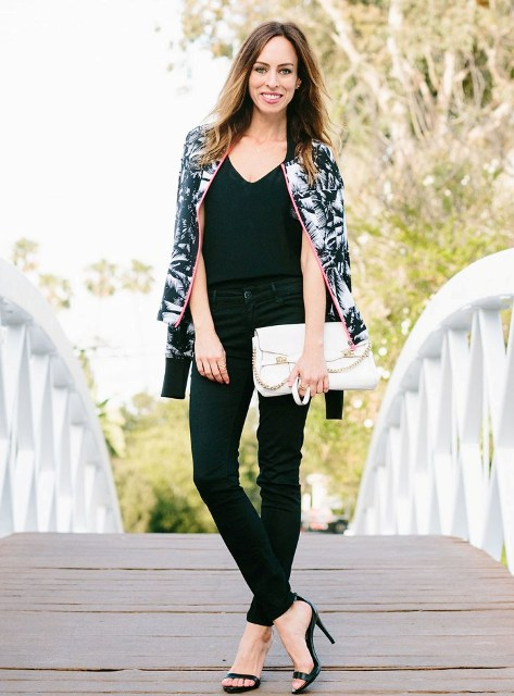 With black top, white clutch, black skinny pants and high heels