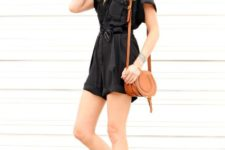With brown leather bag and black flat sandals