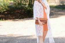 With brown romper, clutch and brown sandals