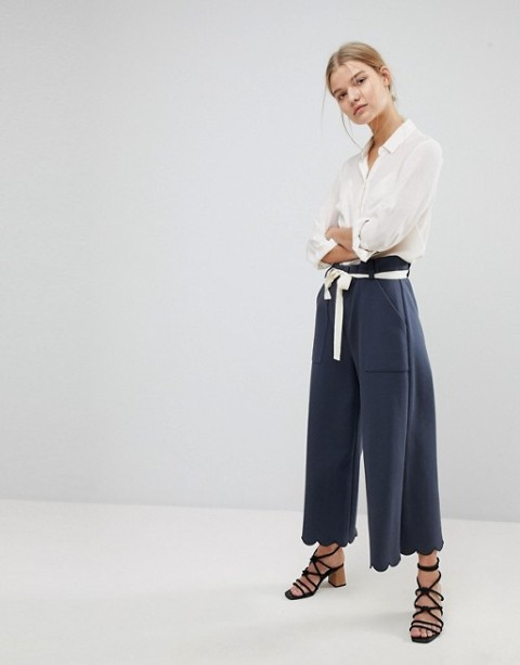 With button down shirt, white belt and lace up sandals