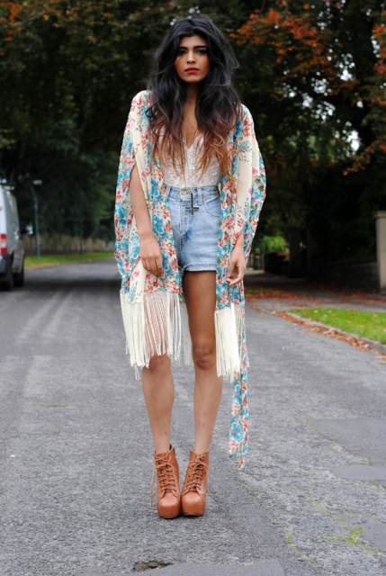 With denim shorts, brown lace up ankle boots and white top
