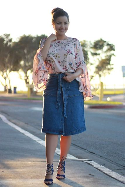With floral ruffled blouse and lace up high heels