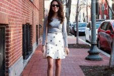 With gray long sleeved shirt, beige bag and white ankle strap shoes