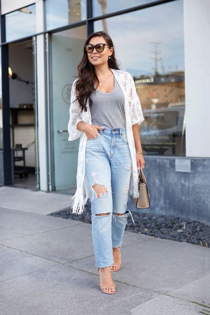 With gray top, distressed jeans, small bag and beige shoes