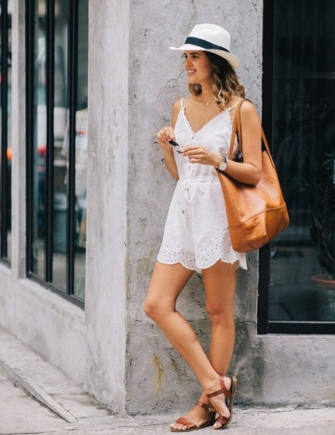 With hat, brown tote bag and brown flat sandals