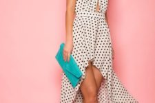 With high heels and turquoise clutch