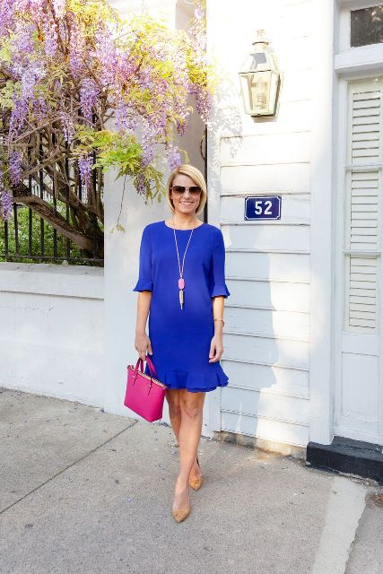 With hot pink small bag and beige pumps