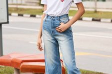 With labeled t-shirt and white flat shoes