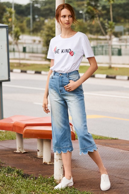 With labeled t shirt and white flat shoes