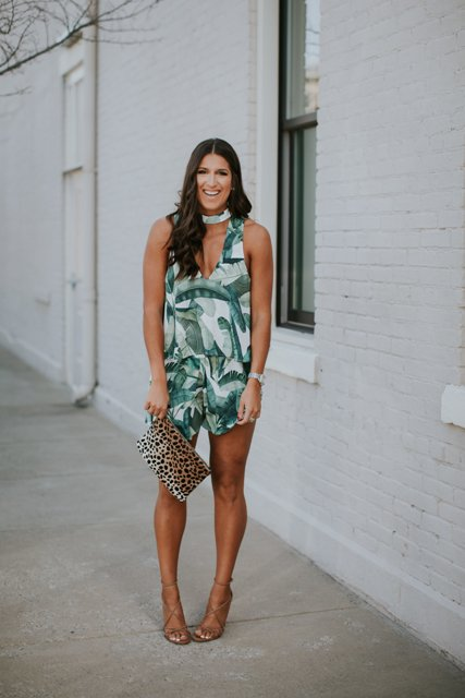 With leopard clutch and lace up heels