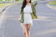 With olive green shirt, beige bag and ankle boots