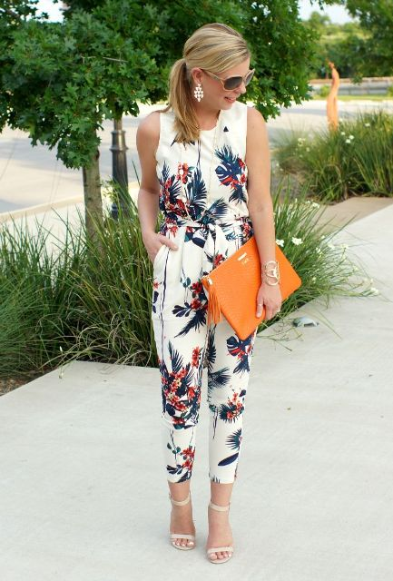 With orange leather clutch and white ankle strap shoes