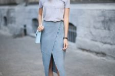 With pastel colored shirt, light blue bag and pale pink pumps