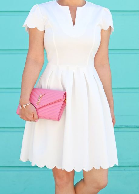 With pink leather clutch