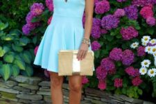 With platform sandals and beige clutch