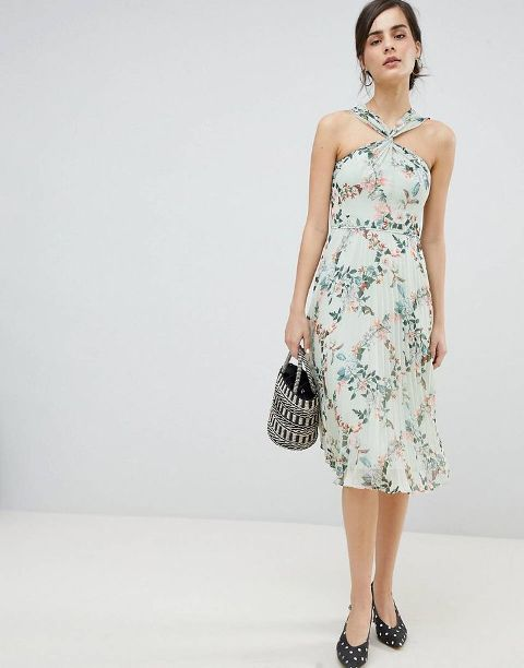 With printed bag and polka dot low heeled shoes