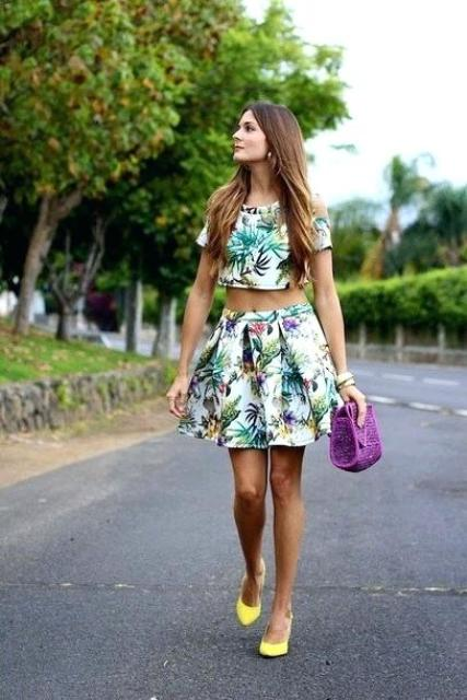 With printed mini skirt, purple bag and yellow pumps