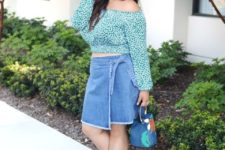 With printed off the shoulder blouse, blue bag and beige heels