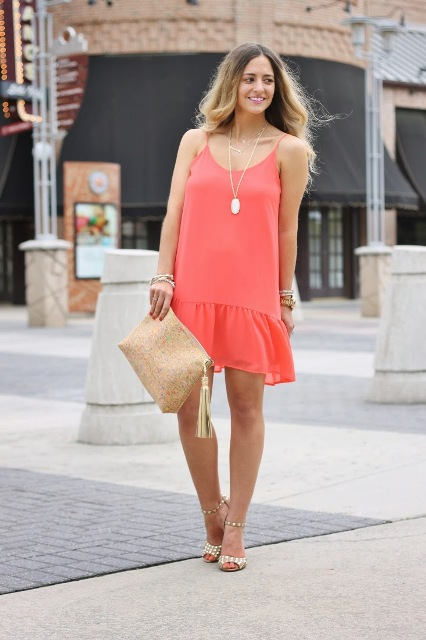 With printed shoes and straw clutch