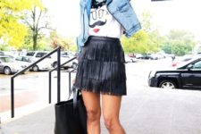 With printed t-shirt, denim jacket, black tote bag and black shoes