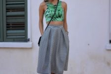 With striped high-waisted skirt, black crossbody bag and black high heels