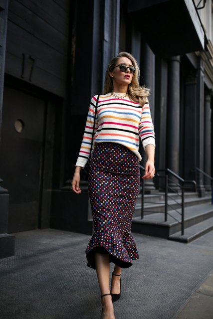 With striped shirt, black bag and black ankle strap shoes