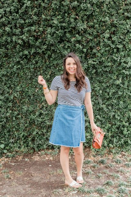 With striped shirt, orange bag and flat shoes