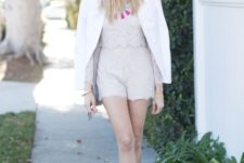 With white blazer, gray bag and beige pumps