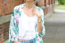 With white crop top and distressed jeans
