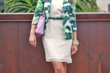 With white dress, lilac bag, high heels and green belt
