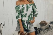 With white framed sunglasses, straw bag and denim shorts
