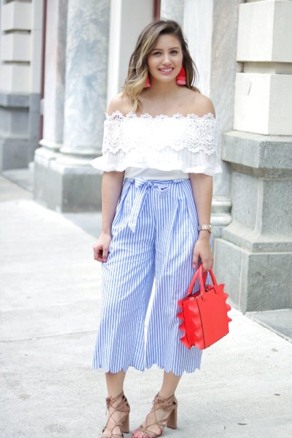With white lace off the shoulder top, red bag and beige lace up sandals