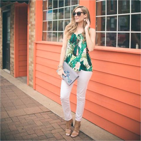 With white pants, printed clutch and brown heeled sandals