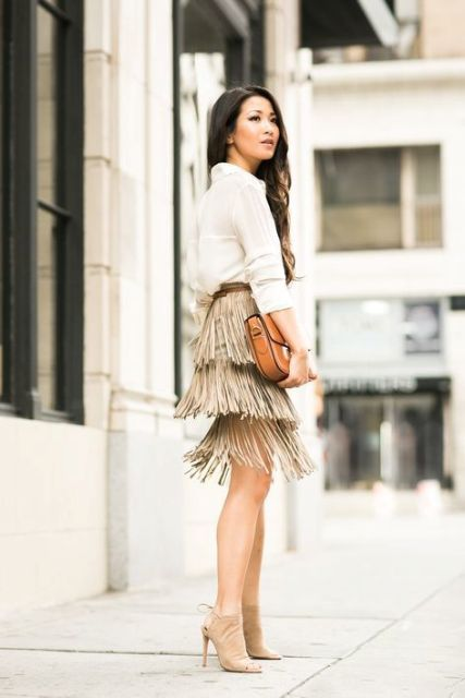 With white shirt, brown leather clutch and beige cutout shoes