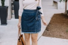 With white shirt, brown tote bag and brown suede boots