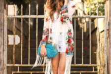 With white shirt, shorts, ankle strap high heels and clutch