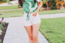 With white shorts and flat sandals