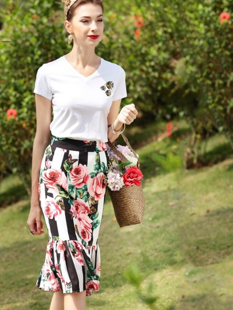 With white t-shirt and straw bag