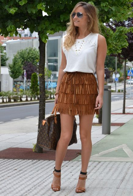 With white top, printed bag and black and brown heels